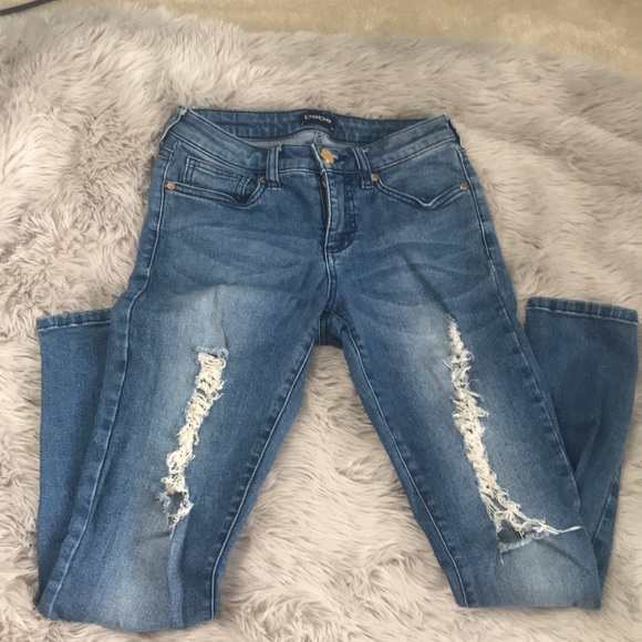Bebe rip and tear jeans